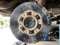 Disk. The car wait on maintenance and fix brake discs in car service garage.  auto, automobile, automotive, brake, car, change, check, clean, component Royalty Free Stock Photography