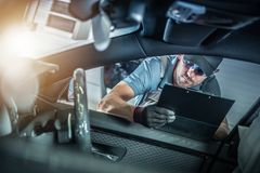 Car Warranty Maintenance. Car Warranty Scheduled Maintenance. Caucasian Automotive Dealership Worker in His 30s Checking In Vehicle Into Dealer Service Section stock photography