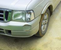 The car was hit by an accident because of abrasions or collapsing. Should be repaired. The car that bumped in the front has dents and has mud attached to the royalty free stock photos