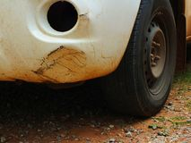 The car was hit by an accident because of abrasions or collapsing. Should be repaired. The car that bumped in the front has dents and has mud attached to the royalty free stock photo