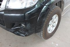 The car was hit by an accident because of abrasions or collapsing. Should be repaired. The car that bumped in the front has dents and has mud attached to the stock image