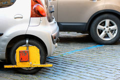 Car was locked with clamped vehicle, wheel lock. Parking on forb Royalty Free Stock Photo