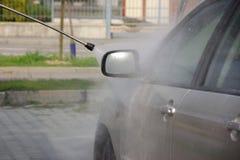 Car wash. Ing by water-jet Royalty Free Stock Photo