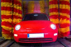 Car wash. Red and yellow color predominant Stock Image