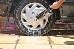 Car wash. Ing showing the car's back tire Stock Image