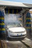 Car wash. White german car wash with soap Royalty Free Stock Image