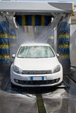 Car wash. White german car wash with soap and yellow and blu brushes Stock Photos