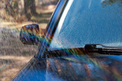 Car Wash. Car Front Window, Mirror and Jet of Water, Waterdrops Stock Images