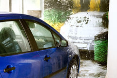 Car wash. Cars in an automatic car wash Royalty Free Stock Photos