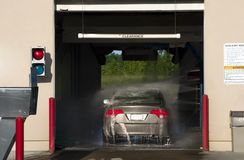 Car wash. The automatic car washing process Royalty Free Stock Images