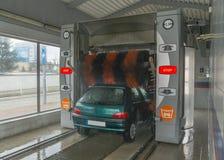 Car wash. Old car Peugeot in car wash Royalty Free Stock Photos