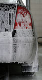 Car wash. Black car in manual wash Royalty Free Stock Photo