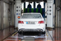 Car wash. Automatic car wash in action Royalty Free Stock Photo