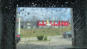 Car wash in automatic car wash. Car in automatic washing and drying stock footage