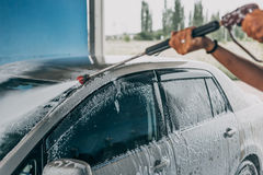 Car Wash closeup. Washing modern bar by high pressure water. Toned stock image