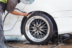Car wash with flowing water Royalty Free Stock Images