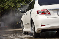 Car wash with flowing water and foam. Royalty Free Stock Image