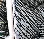 car wash foam patterns on a car window royalty free stock image