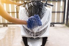 Car wash,Happy man cleaning motorcycle wash foam water at home. Car wash,Happy man hand cleaning motorcycle wash foam water at home stock photos