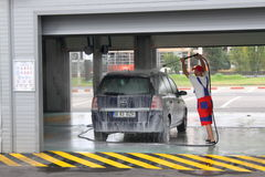 Car wash. Man working in car wash at Bucharest,Romania royalty free stock photo