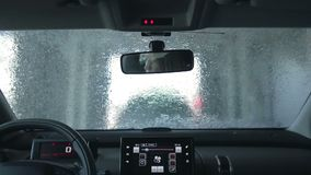 Car wash with pressured water stock video footage