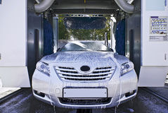 Car wash in process. Car wash process and interior with brushes Royalty Free Stock Photography