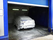 Car wash at the service station. Service and maintenance of transport. Details and close-up. stock photography
