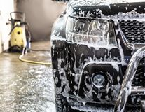 Car at car wash. Shampoos royalty free stock images