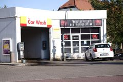Car wash Shell gas station. Mainz, Germany - September 15, 2018: A car is parked in front of a car wash at the Shell petrol station on September 15, 2018 in stock photography