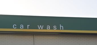Car wash sign. A car wash is a place or structure having special equipment for washing automobiles, to apply water or some other liquid to for the purpose of Royalty Free Stock Photo
