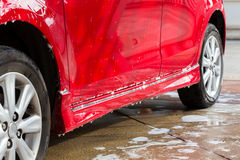 Car wash with soap, car cleaning. Service Royalty Free Stock Images
