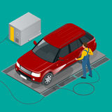 Car wash specialist in uniform washing off-road car. Spraying water from the hose. Flat 3d vector isometric illustration Royalty Free Stock Images