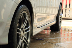Car wash with water. And foam cleaning royalty free stock image
