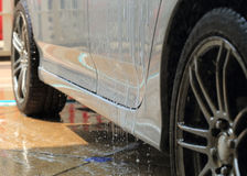Car wash with water Royalty Free Stock Photography