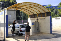 Car wash. Where customers themselves wash their cars with high-pressure jets free service Royalty Free Stock Images