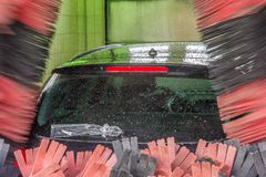 Car in a car wash with wrapped rear wiper stock images