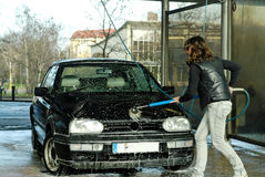 Car washer. A girl washing a vw golf Royalty Free Stock Photos