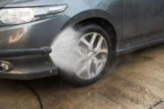 Car washing cleaning with foam and hi pressured water Stock Images