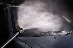 Car washing cleaning with foam and hi pressured water/selective Royalty Free Stock Images