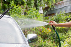Car washing cleaning with foam and hi pressured water Stock Image