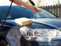 Car washing cleaning with foam and  water Royalty Free Stock Images