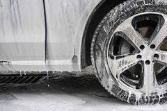 Car washing concept. Car in foam. details close up. royalty free stock images