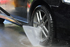 Car washing with flowing water. Outdoor Self Service Cleaning Car Using High Pressure Water Stock Photo