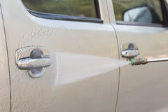 Car washing with high pressure water jet Royalty Free Stock Image