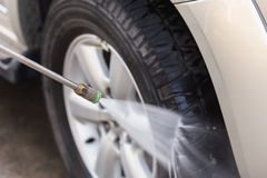 Car washing with high pressure water jet Stock Photography