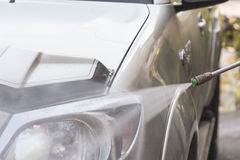 Car washing with high pressure water jet Stock Image