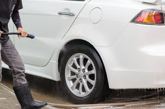 Car washing using high pressure water jet. Royalty Free Stock Image