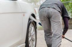 Car washing using high pressure water jet. Royalty Free Stock Images