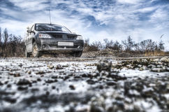The car in the wasteland. Abandoned empty space,gravel,Dry the machine is dirty Stock Photo