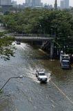 Car in water. BANGKOK - NOV 10: worst flood disasters in 50 years hits Bangkok streets. Bangkok flooding, 10 November 2011 Royalty Free Stock Photo